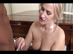 Blonde MILF fucked by young...