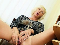 Attractive older Milf wears...